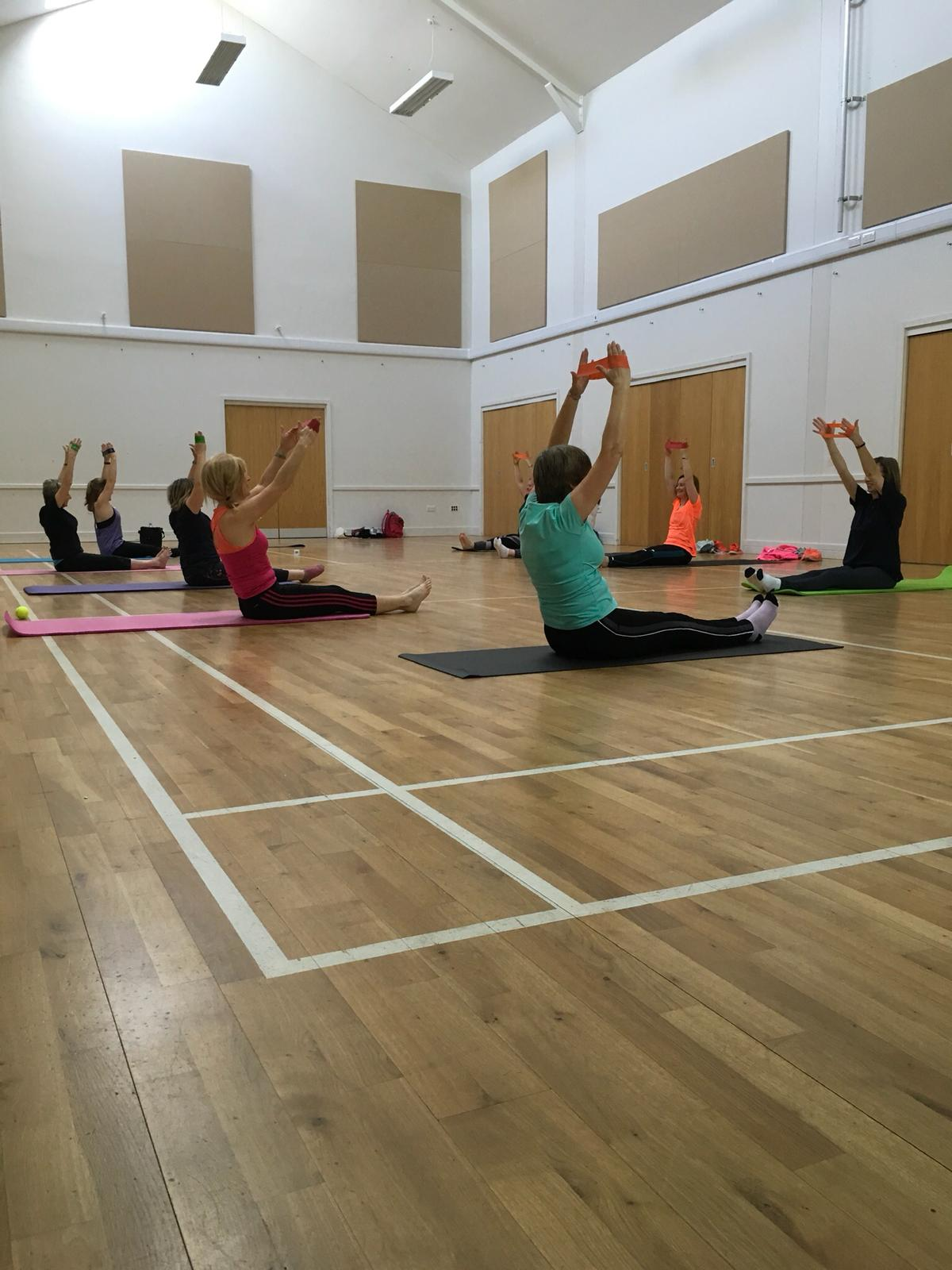 Students taking part in Pilates class.